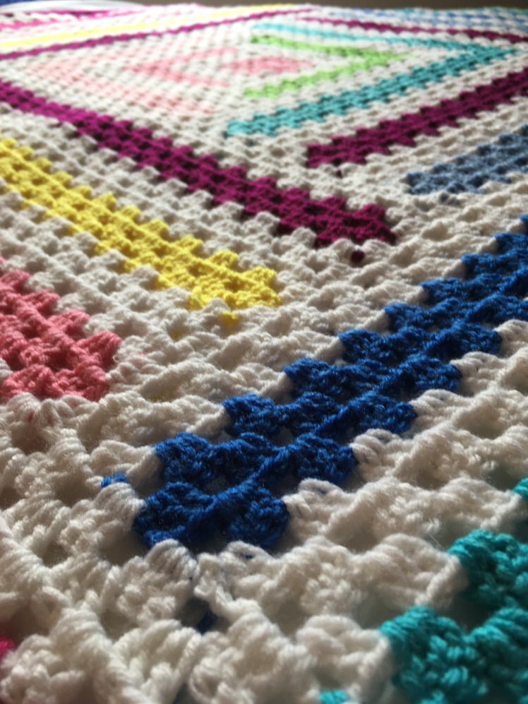 A close up of the Granny Stripes in the free pattern, LogCabin Twist by CoffeeandCrochetGoals