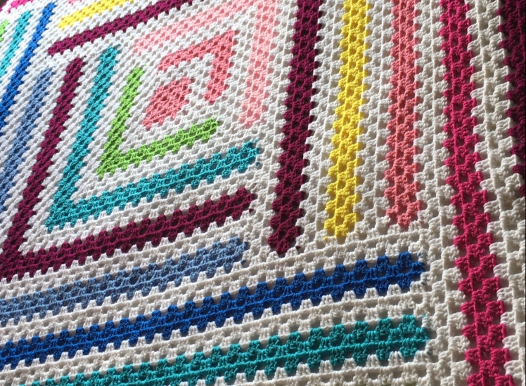 A close look at the stacking granny stripes in the Log Cabin Twist free crochet pattern by Coffeeand CorchetGoals