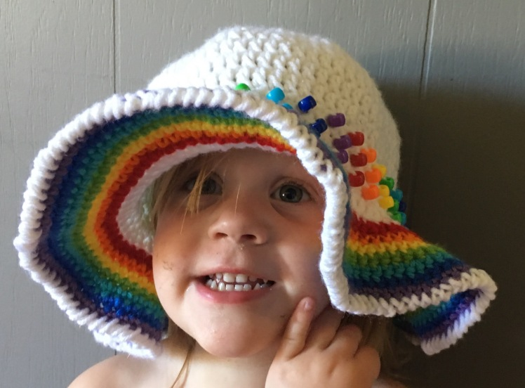 This fun and easy crochet sunhat has an extra touch of whimsy with the added pony bead band,
