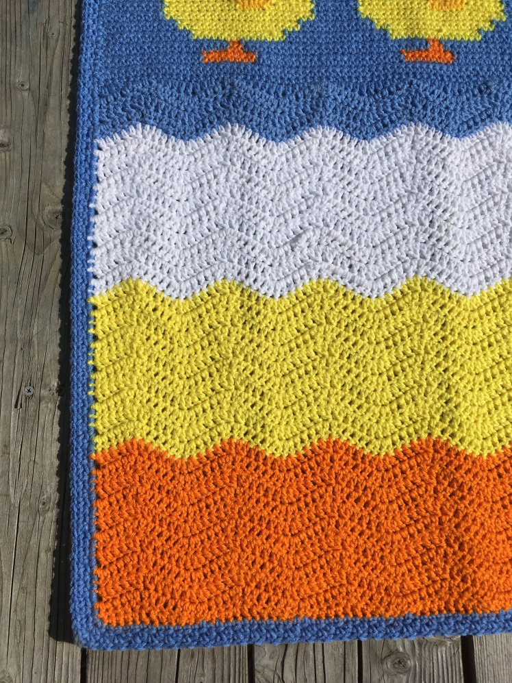 Showing off the ripple part of the free crochet baby blanket Duck, duck, goose