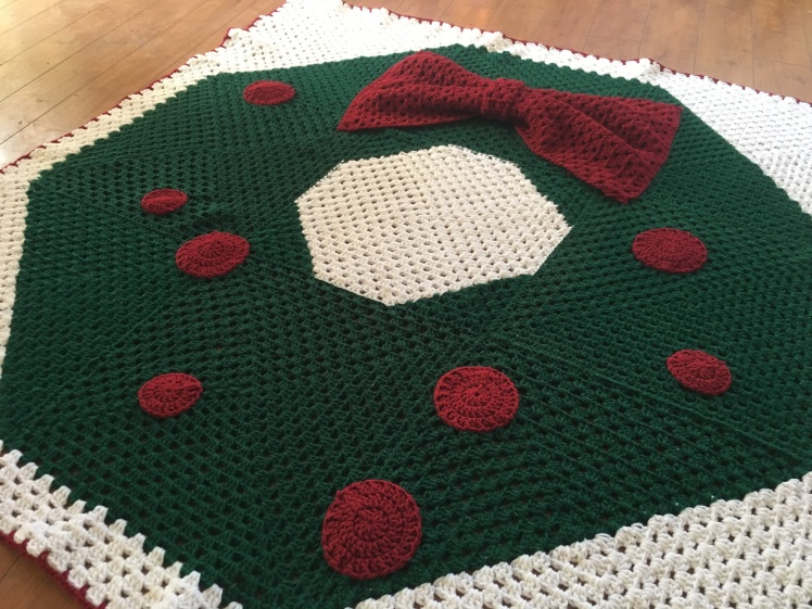 This full view shows the easy nine granny squares sewn together to make the Christmas Wreath Blanket